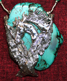 Sterling silver pony head and feathers on turquoise